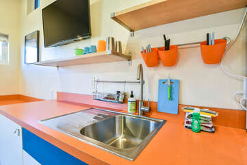 Kitchenette in bedroom with nearby tv