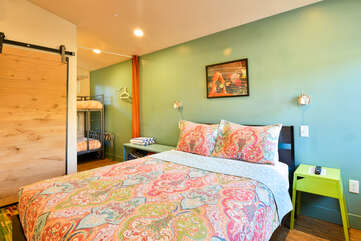 Sleeping Arrangement with large bed and nearby bunks