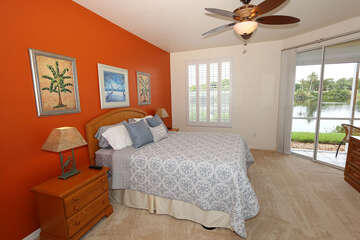 Master bedroom with lanai access and lake view