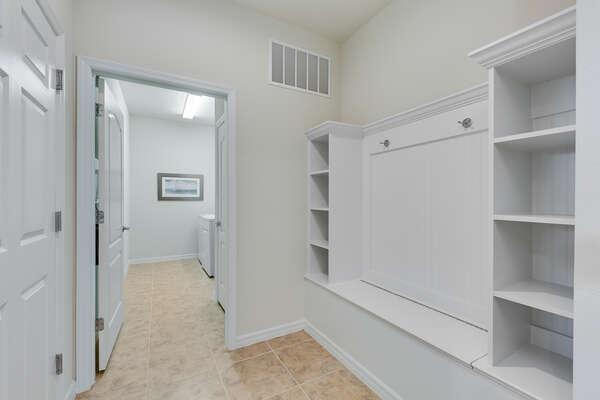 The large laundry room has plenty of storage space