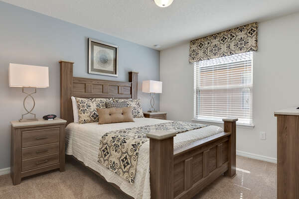 Sleep peacefully in this queen bed