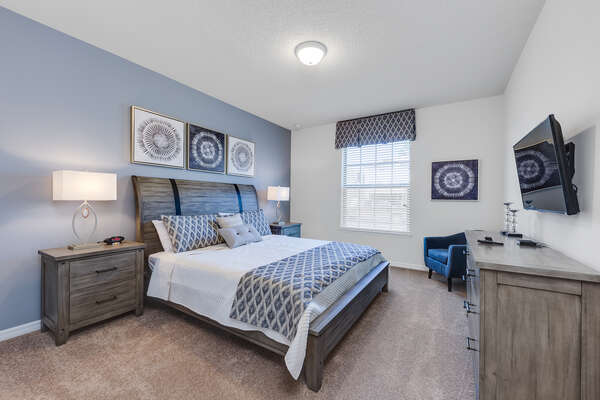 Master bedroom with a king-sized bed