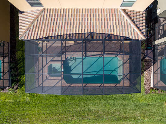 The private pool is screened in for your comfort