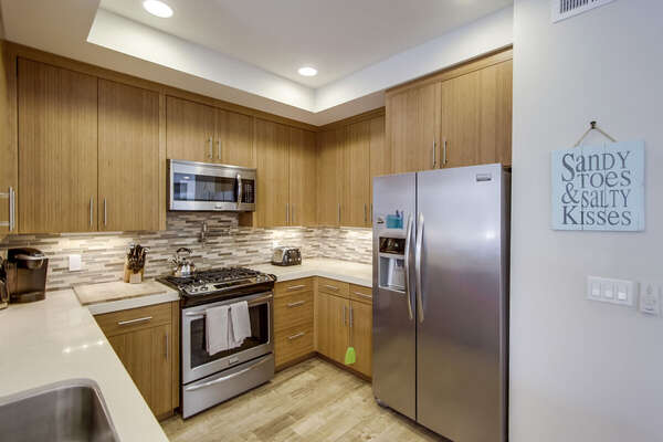 Kitchen Includes Stainless Steel Appliances.