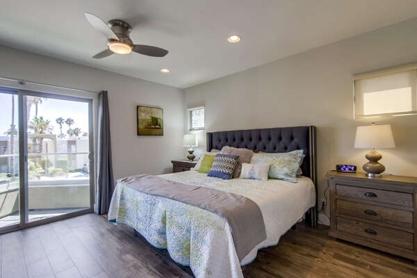 Spacious Bedroom Includes Bed and Two Night Stands.