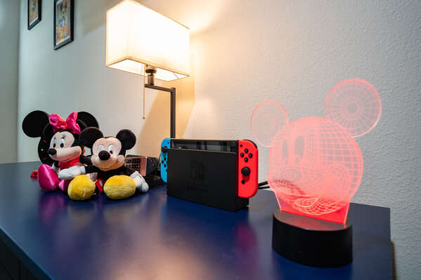close up of dresser items featuring Disney items and Nintendo Switch