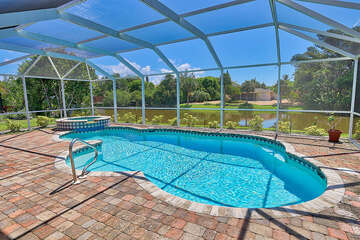 Screened in pool and spa, with lake view