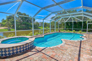 Screened in pool and spa with lake view
