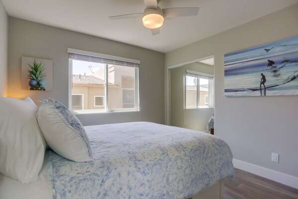 Guest Room with Queen bed and ocean themed paintings.