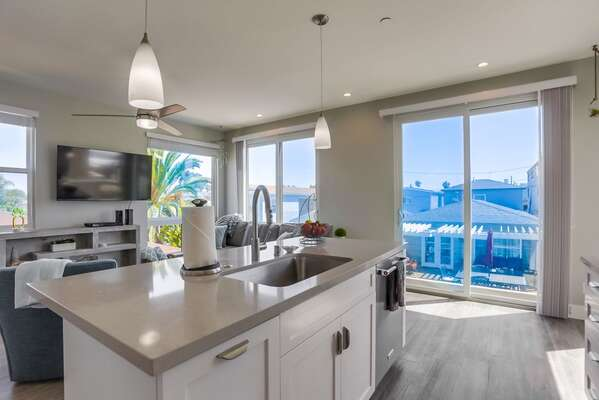 State-of-the-Art Kitchen with modern appliances and views into the living area.