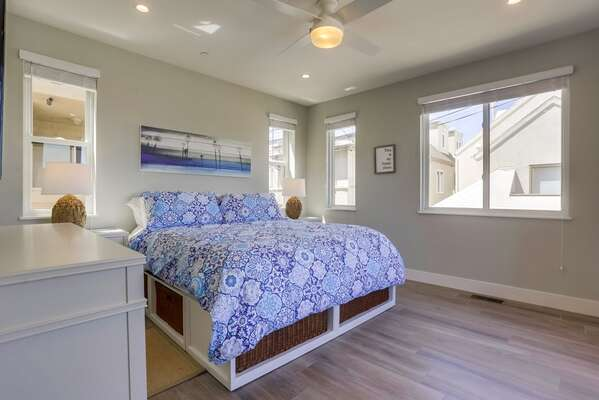 Master Bedroom with King bed, dresser, and twin nightstands.