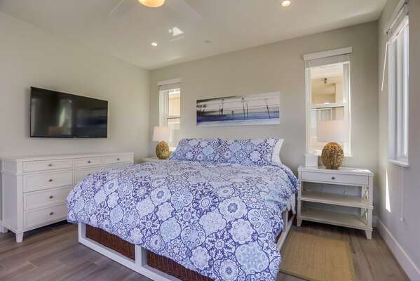 Master Bedroom with King bed and wall mounted TV.