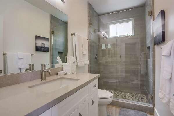 Master En-Suite Bath with vanity sink, walk in shower, and toilet.