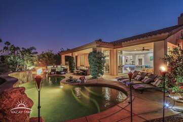 The oversized pool opens up to the golf course and has LOTS to do!
