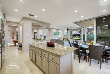 Wide open floor plan and large windows make it easy to keep an eye on the pool