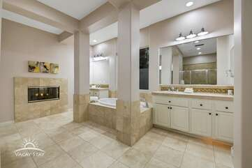 The master bathroom is enormous.  Enjoy the gas fireplace from the tub. Bathroom 1