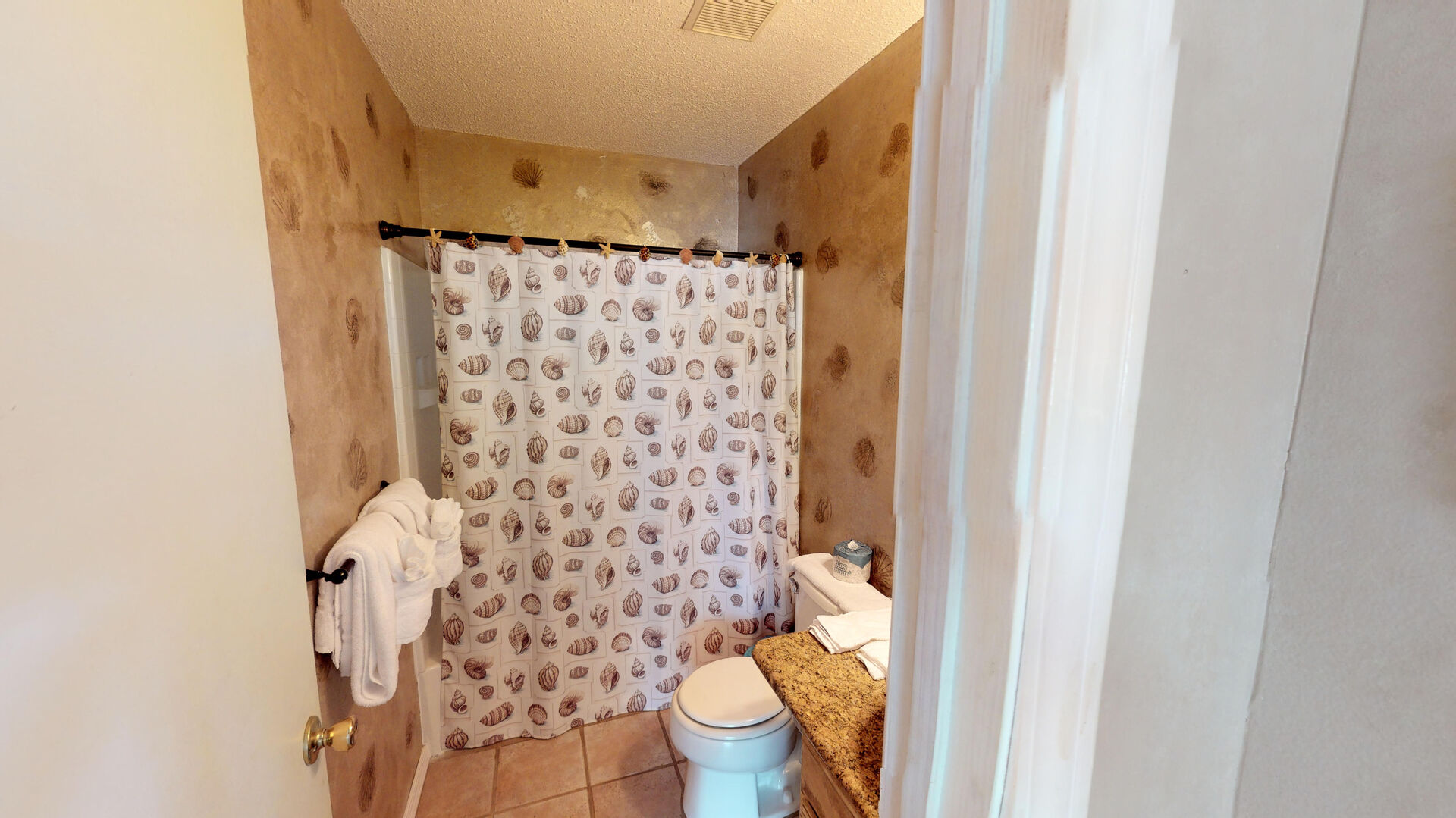 Bathroom with Shower, Toilet, and Single Vanity Sink.