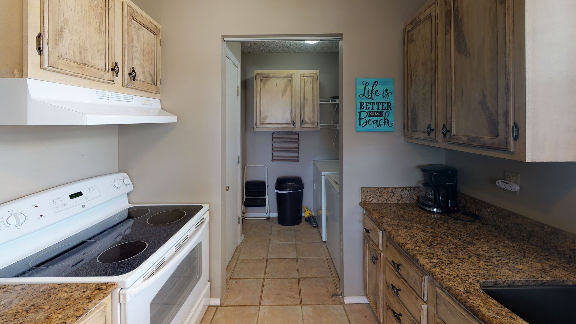 Kitchen with Coffee Maker, and the Laundry Room.