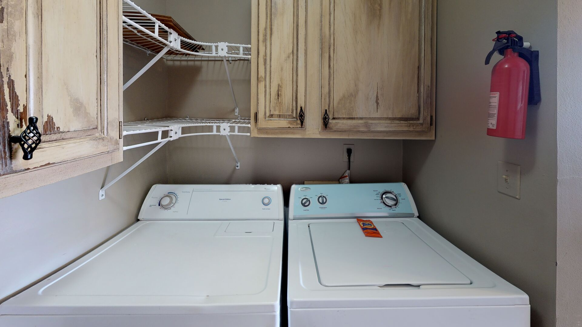 Washer, Dryer, and Wall Cabinets in the Laundry Room.