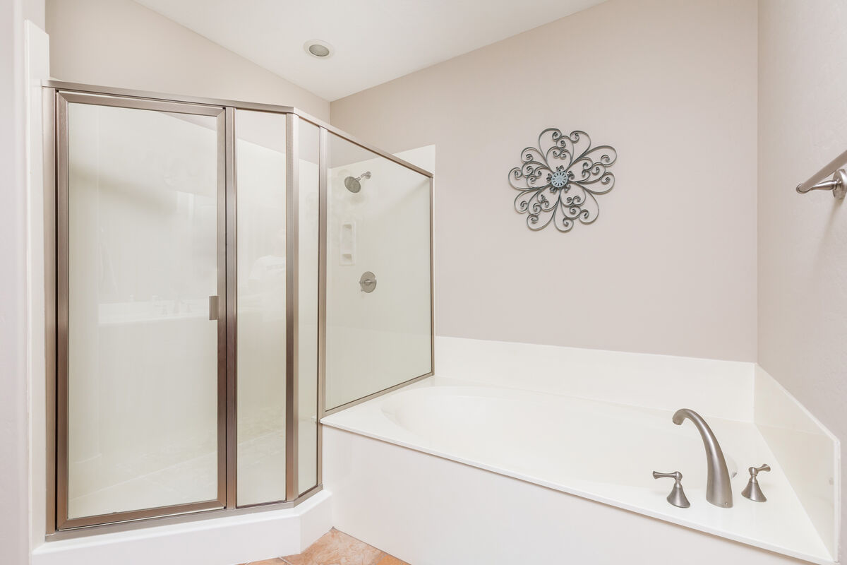 Master bathroom has has large soaking tub and stand in shower