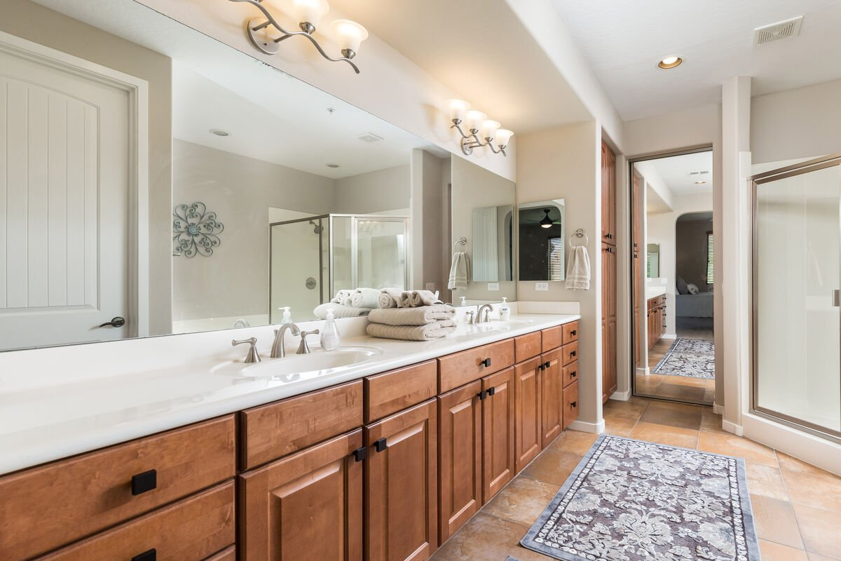 Master bathroom is well lit and has dual sinks. No bumping elbows!