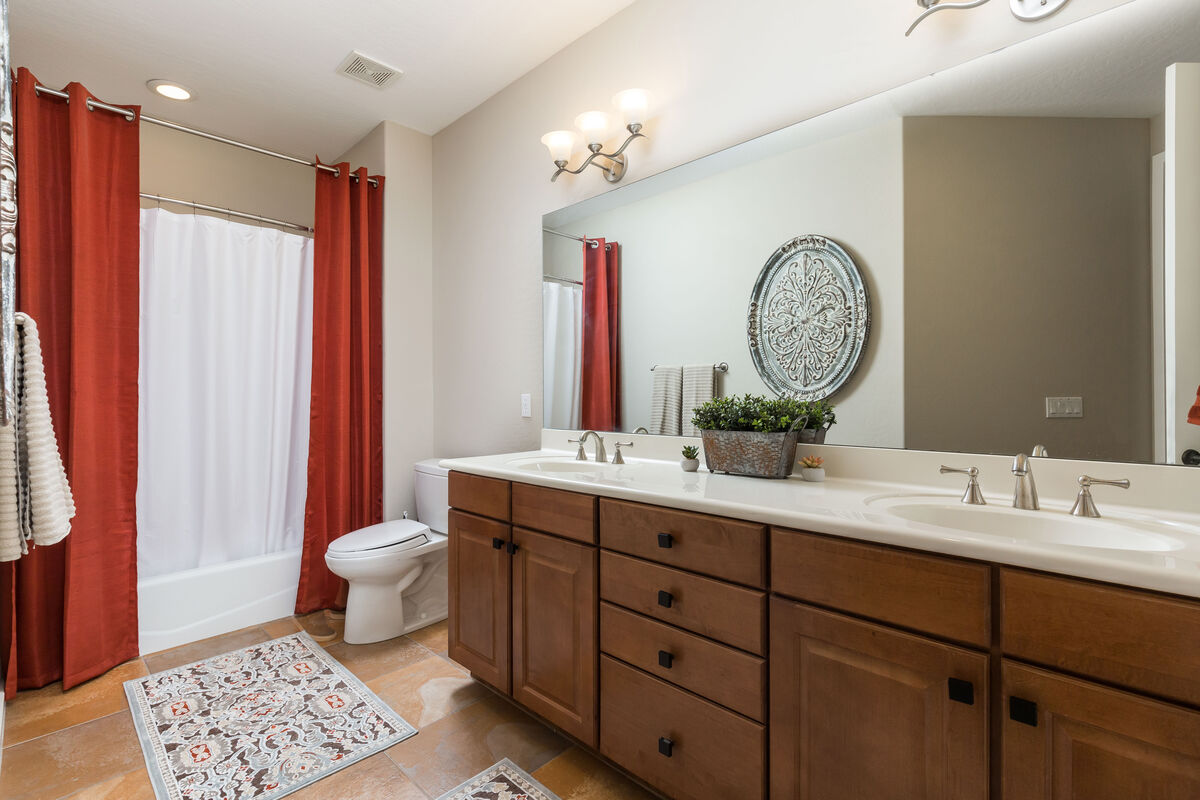 Guest bathroom- Tub/shower combo with dual sinks