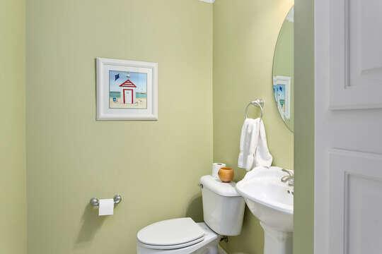 Toilet, Pedestal Sink, and Mirror.