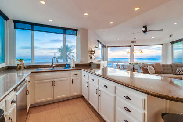 Kitchen with modern appliances and ocean views.
