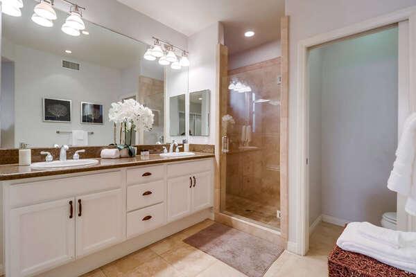 Master En-Suite Bath with walk in shower and double vanity sink.