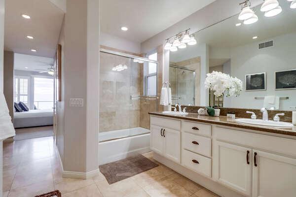Master En-Suite Bath with luxury tub and vanity sink.