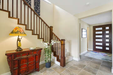The front entryway of this Kona Hawaii vacation rental with stairs leading to the upper floor.