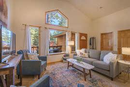 Living Room Looking Towards Front Door, Laundry Room, and Garage