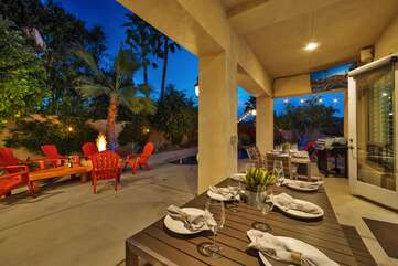 Two large tables for outdoor dining can be pushed together to seat up to 16 guests at the same table!