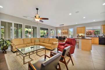 Open floor plan with plenty of seating options in the living room to watch the 65