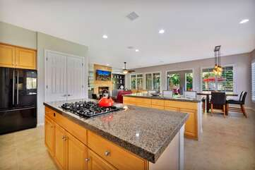 The kitchen has TWO center islands for your convenience with the stovetop in the center