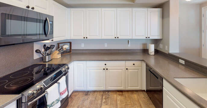 Kitchen with long countertops and oven
