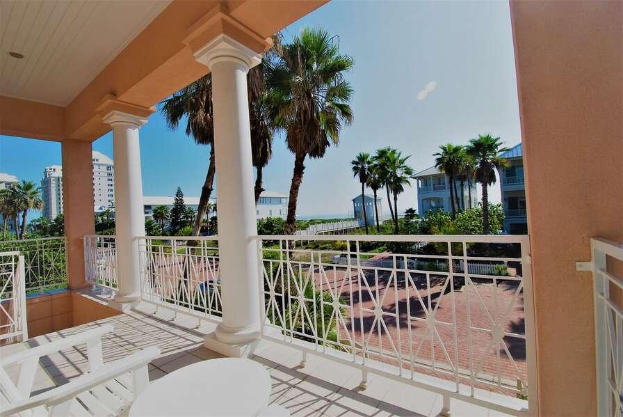 Balcony overlooking neighborhood and dune walkover to beach