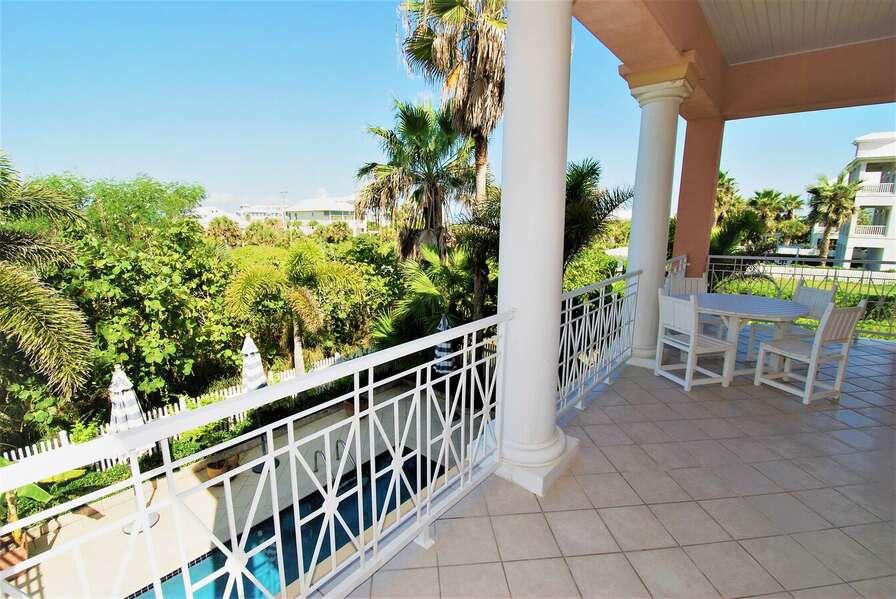 Master bedroom balcony overlooking swimming pool