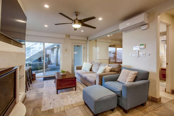 Living Area Includes Sofa and Blue Chair.