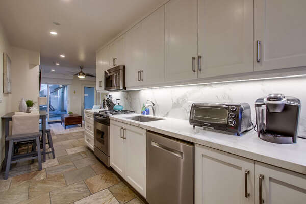Kitchen is Fully Stocked with Stainless Steel Appliances.