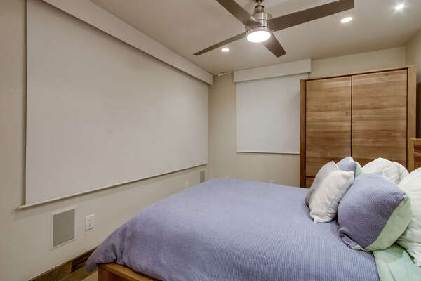 Image of Master Bedroom with Shades Down.