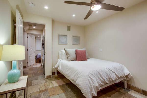 Image of Queen Bed in Guest Bedroom.
