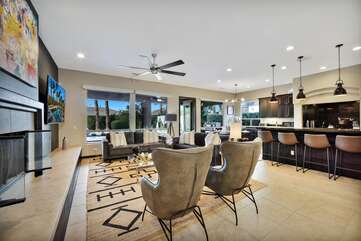 Fireplace and the large windows provide a great view of pool and surrounding La Quinta mountains