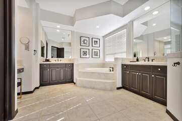 Master Bath has his & hers sinks, step in shower and huge tub