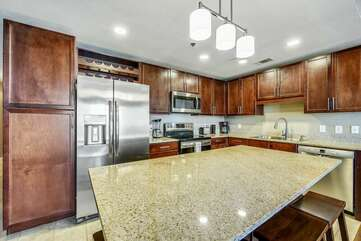 Spacious kitchen with large island and stainless steel appliances