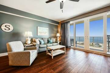 Beautiful spacious living room with entrance to the balcony overlooking the Gulf of Mexico