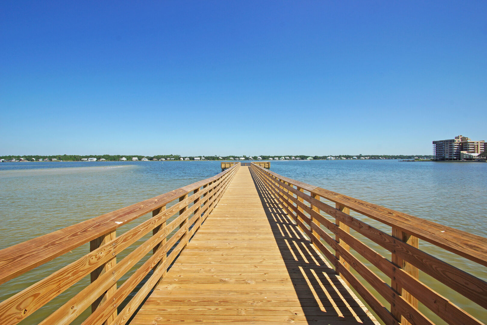 Just outside the home is a brand new fishing pier