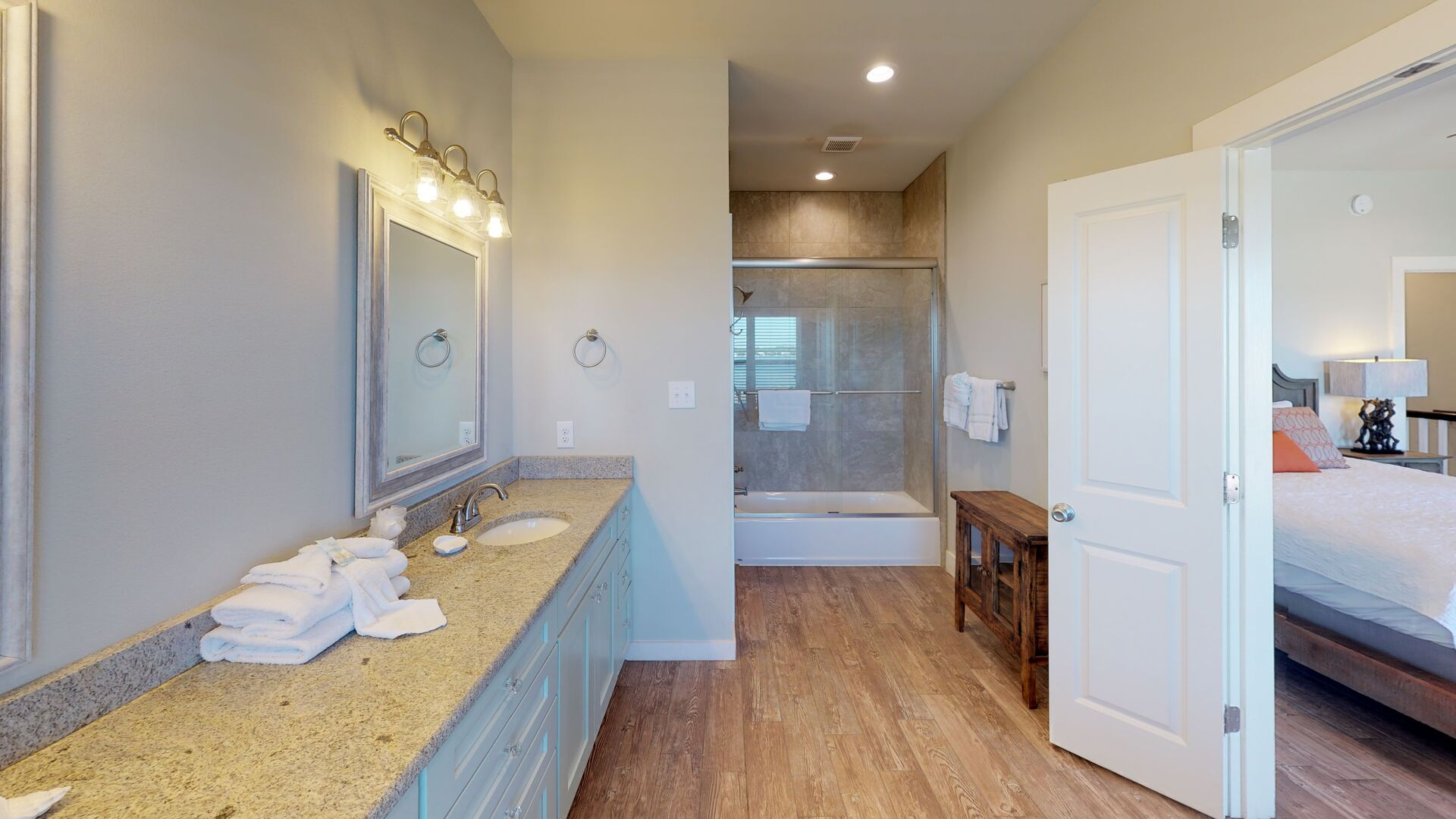 Large master bathroom has a tub/shower combo