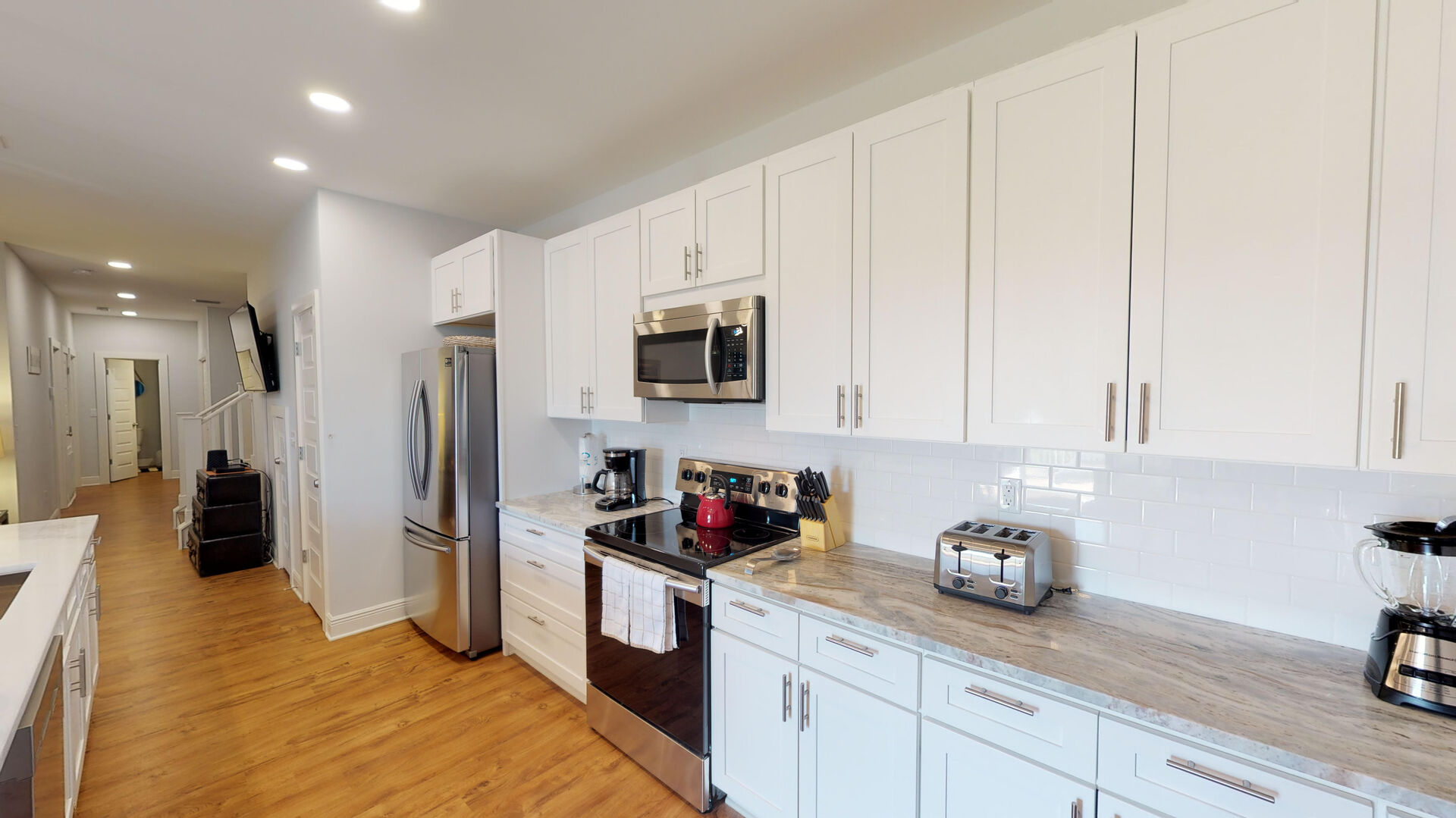 Kitchen with Refrigerator, Microwave, Toaster, and TV.