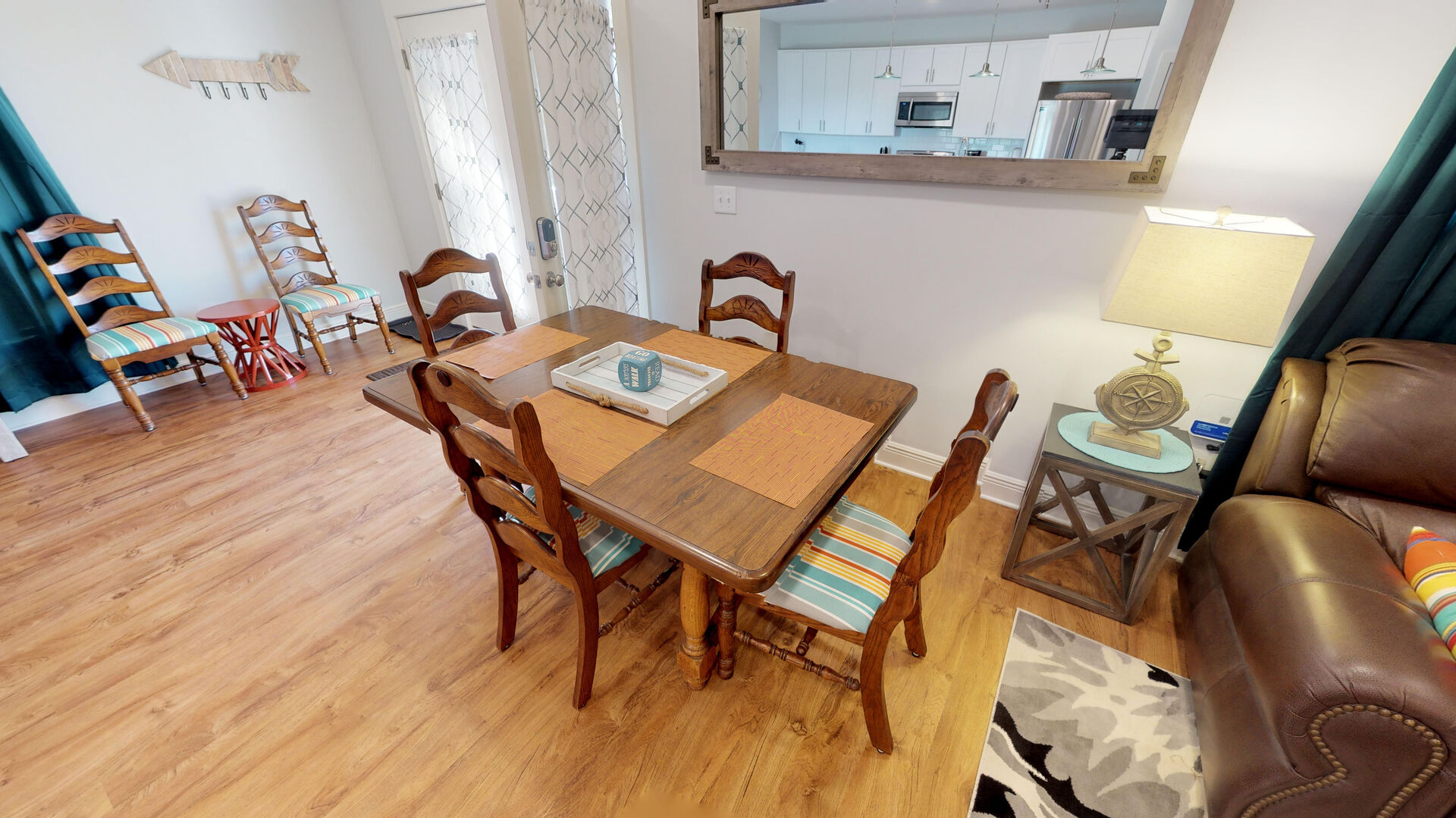 Dining Table, Chairs, Side Table, Table Lamp, Mirror, and Sofa.